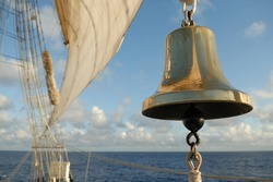 bell and sea sail on the ocean background