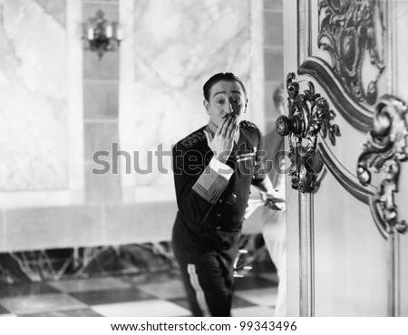 bell boy blowing a kiss