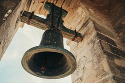 Bell in steeple on top of a village in Andalusia, Spain.