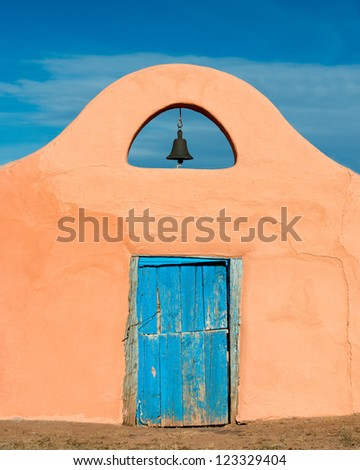 Bell over blue door in Santa Fe, New Mexico