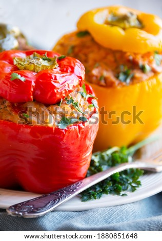 Bell peppers stuffed  with  meat and some parsley, healthy vegetable dish Stock photo ©