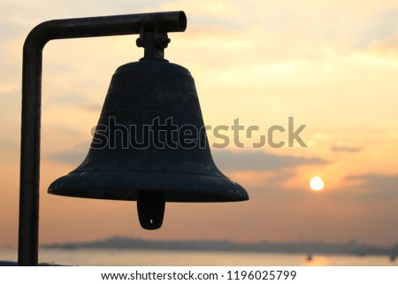 Bell silhoutte and sunset #1196025799
