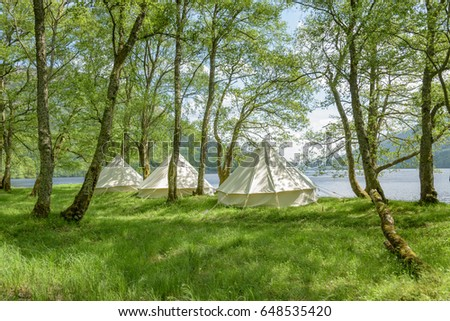 Bell tents at erected at a woodland beside Loch Voil in Scotland. #648535420