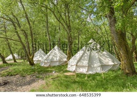 Bell tents at erected at a woodland beside Loch Voil in the Loch Lomond and Trossachs National Park in Scotland. #648535399