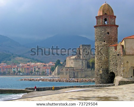 Bell tower and castle in the Mediterranean village of Collioure with stormy sky, Vermilion coast, Roussillon, Pyrenees-Orientales, France
