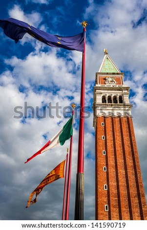 Bell tower and flags on St. Mark's Square, Venice