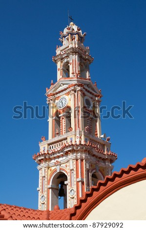Bell tower of Panormitis Monastery in Symi, a Dodecanese island, Greece.