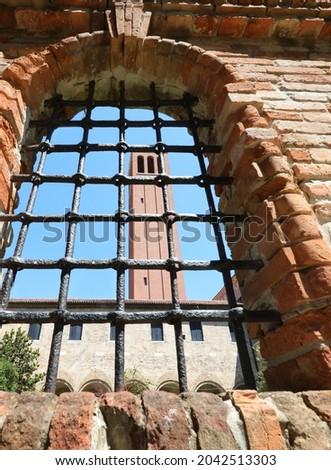 bell tower of the island of Santa Elena seen through a metal grate near VENICE in Italy Stok fotoğraf ©