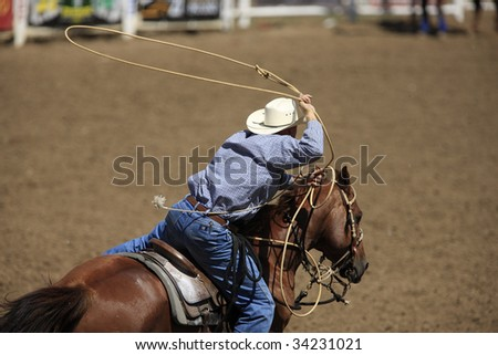BELLE FOURCHE, SOUTH DAKOTA - JULY 4:  Tie-down roping competition at the 90th annual Black Hills Roundup rodeo in Belle Fourche, South Dakota July 4, 2009.