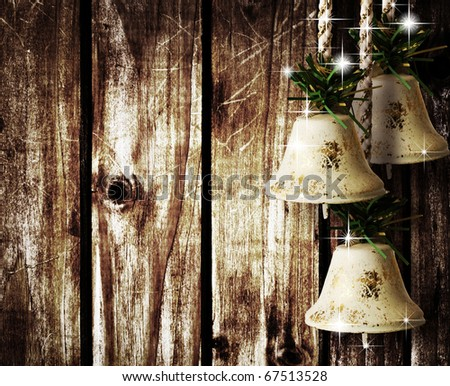 bells and stars on wooden wall
