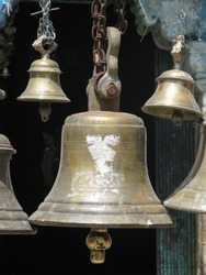 Bells made of various metals hanging side by side outside Hindu Temples