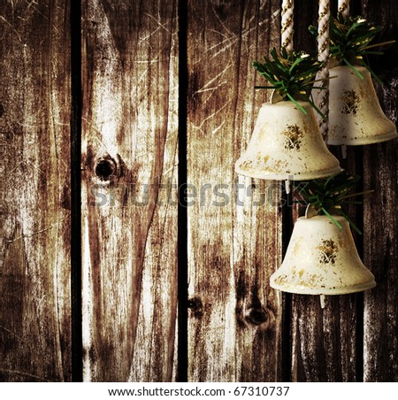 bells on wooden wall
