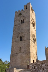 Belltower of the Assumption Cathedral at Madrice square in Erice on Sicily, Italy