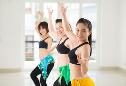 Belly dancers performing together in the studio