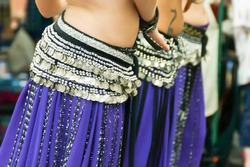 Belly dancers performing with coin belts.