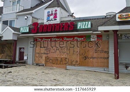 BELMAR, NEW JERSEY/USA -Â?Â? OCTOBER 30: Damaged store fronts along Ocean Ave the day after Hurricane Sandy on October 30, 2012 in Belmar New Jersey.