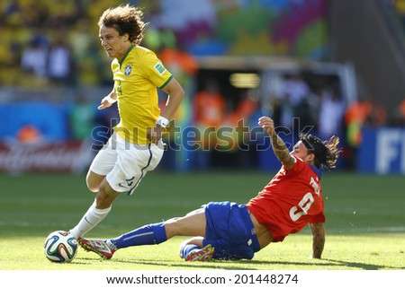 BELO HORIZONTE BRAZIL June 28 2014 David Luiz and Mauricio Pinilla at the 2014 World Cup Round of 16 game between Brazil and Chile at Mineirao Stadium No Use in Brazil