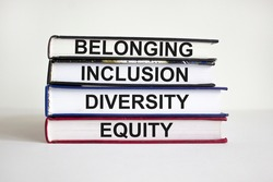 Belonging symbol. Books with words 'belonging, inclusion, diversity equity' on beautiful white table, white background. Business, belonging, diversity and inclusion concept. Copy space.