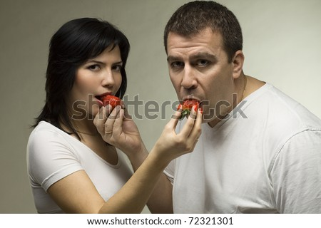 Beloved couple with red strawberries