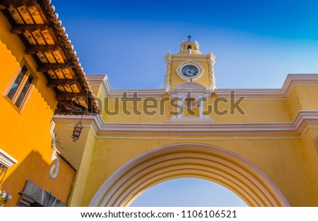 Below view of Santa Catalina arch with a gorgeous blue sky background durig a beautoful sunny day in Antigua city