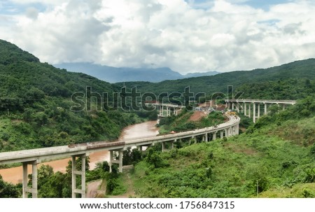 Belt and Road Initiative: Chinese Xiaomo Highway bridge under construction in the green jungle between Lao border town Boten and Mengla, Yunnan, China ストックフォト ©
