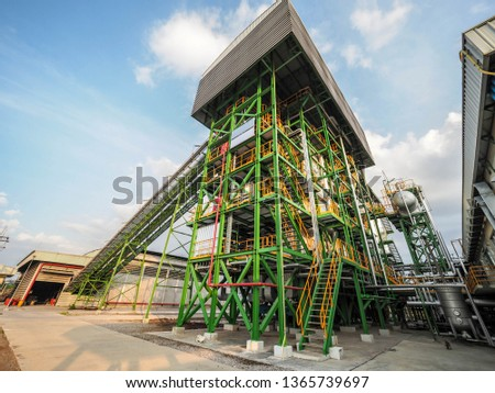 Belt conveyer of feed woof chipper fuel systems to boiler for product steam to steam turbine generator in biomass power plant. #1365739697