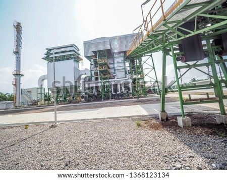 Belt conveyer of feed woof chipper fuel systems to boiler for product steam to steam turbine generator in biomass power plant. #1368123134
