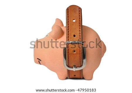 Belt fastened  on a piggy bank isolated on white - stock photo