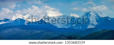 Belukha Mountain is the highest point of Altay. Panoramic view of snow-capped peaks in the evening light. #1353683159