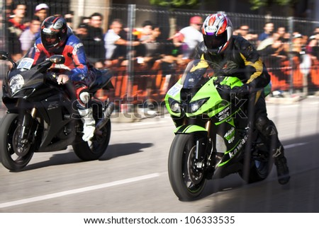 "BEMBIBRE, SPAIN - JUNE 23: Motorcyclists unidentified with Kawasaki Ninja ZX10RR and Suzuki GSXR in the 3rd motorcycle rally ""Bierzorros&qu ot; in Bembibre (Leon) on June 23, 2012 in Bembibre, Spain."