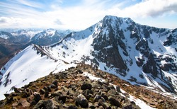 Ben Nevis, the highest point in Scotland and the UK, as seen from the Carn Mor Dearg arete climbing route.
