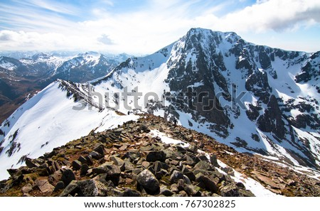 Ben Nevis, the highest point in Scotland and the UK, as seen from the Carn Mor Dearg arete climbing route. #767302825