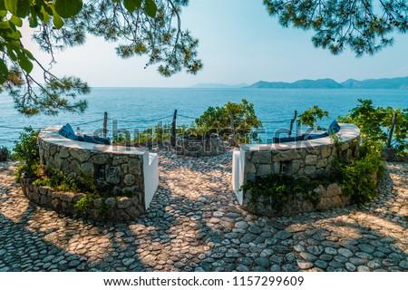 benach wit a look at the ocean of Faralya coast Fethiye Turkey,