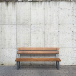 Bench against concrete wall