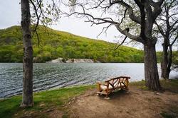 Bench along Hessian Lake, at Bear Mountain State Park, New York.