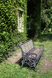 Bench and ivy house in local resort