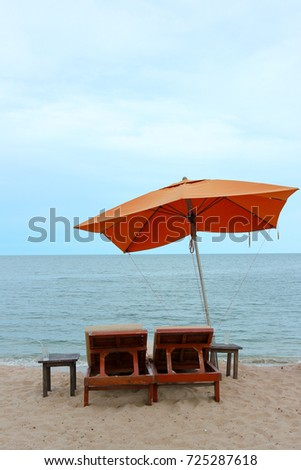 bench and umbrella on the beach summer time vacation #725287618