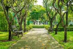 Bench and walkway in the garden of Suan Luang Rama 9 public park