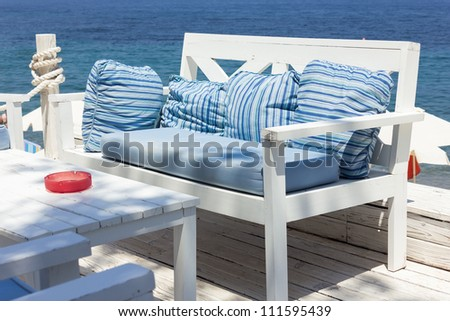 Bench by the sea - stock photo