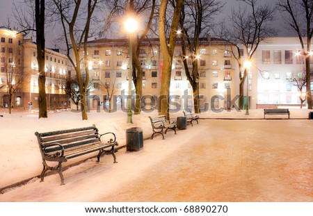 Bench in evening winter city