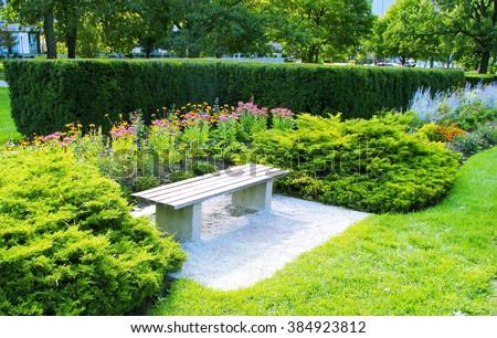Bench in garden. Bench in public garden, Toronto, Canada
