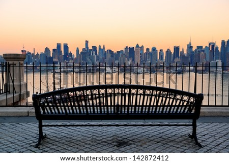 bench in park and new york city ...