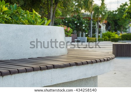 Bench in the garden at the morning. #434258140