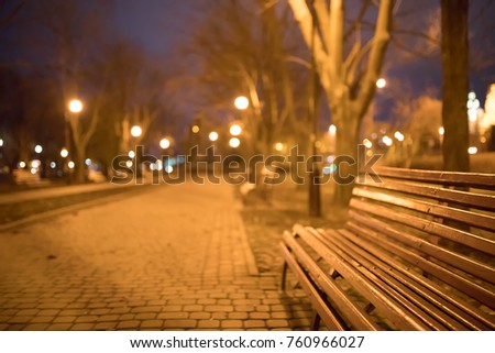 Bench in the park at night #760966027