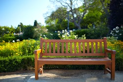 Bench in the park in Barcelona. Warm colors. Color corrected in LAB.