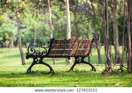Bench in the peaceful public park in Bangkok