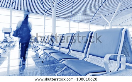 Bench in the shanghai pudong airport,the passenger walking along the bench, interior of the airport. - stock photo