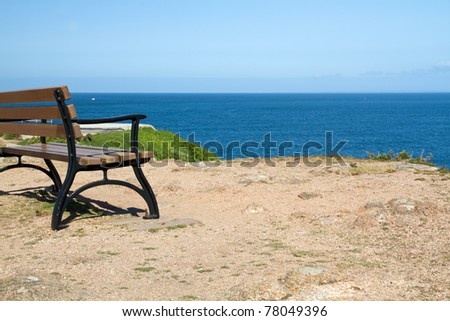 Bench looking out to the sea on coast of Jersey, UK