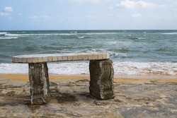 bench made of granite and stone on the shore of the Atlantic ocean