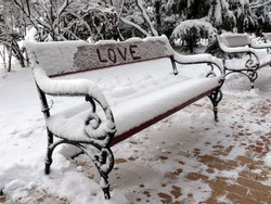 Bench of love with snow in Sofia, Bulgaria